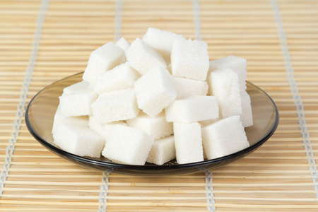 sugar cubes: Sugar cubes on a plate Stock Photo