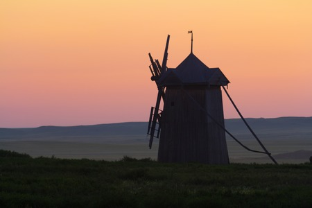 blades: Windmill with the broken blades at sunset