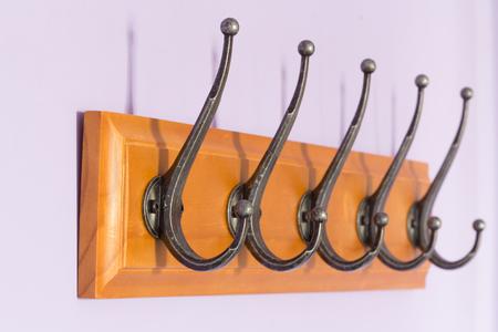 coat rack: Wooden coat rack on the wall Stock Photo