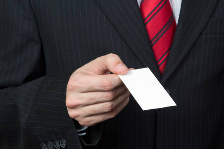 unrecognizable: Unrecognizable businessman holding a card in hand