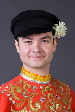russian ethnicity caucasian: Portrait of a young guy wearing a folk russian costume, studio picture