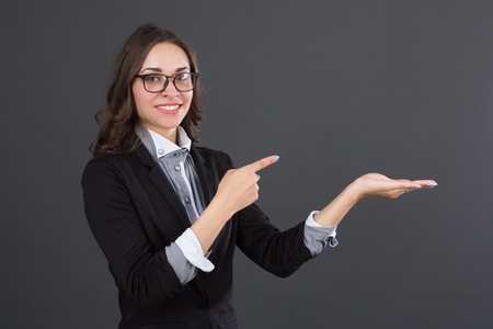 studio picture: business women pointing an idea, studio picture
