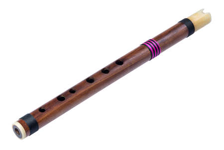 Thai wooden flute isolated on white background