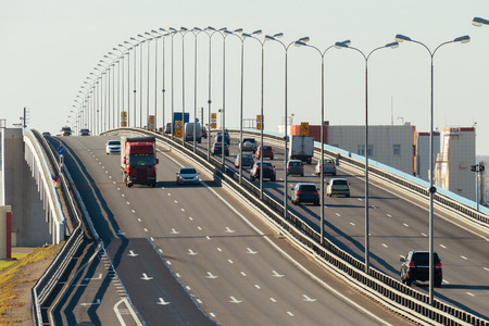 pkw: several trucks and cars driving on the highway in the afternoon Stock Photo