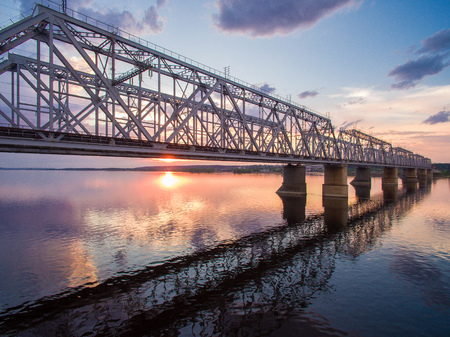 beautiful aerial view of the railway bridge across the Volga river at sunset Stock Photo