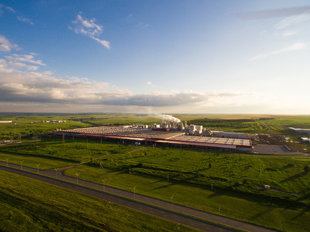 tatarstan: a huge concrete plant with pipes among the fields. aerial view