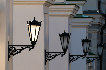 tatarstan: Old iron street lanterns on a white wall