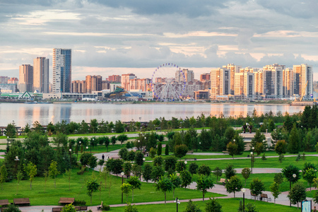 tatarstan: Beautiful urban landscape with a road, a Park and a lake at sunset Stock Photo