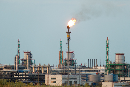 Huge gas and oil processing plant with burning torches, pipes and distillation of the complex Stock Photo