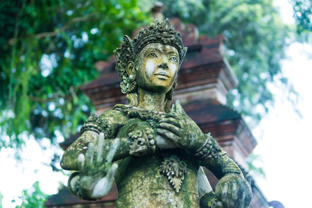 Close up woman statue Indonesian-style, Fairy statue in the garden, lady in the garden, Beautiful woman statue in the park. Taman Tirtagangga temple on Bali Reklamní fotografie