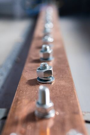 Electric copper bus bars, bolting the live parts of the transformer Stock Photo
