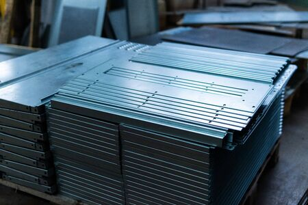 Steel sheets deposited in stacks in packs at the warehouse of metal products. Weathered metals sheet for construction. Metal corrosion