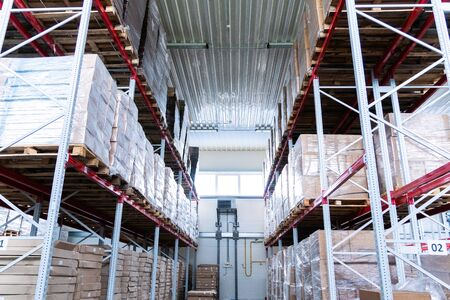 storage warehouse and racks on which there are cardboard boxes with finished products