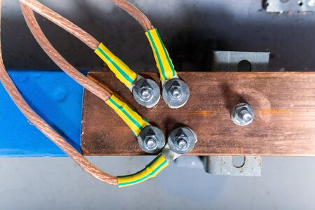 copper busbar, colored wires on metal base. Part of transformer Stock Photo