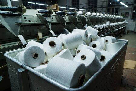 old knitted fabric. Textile factory in spinning production line and a rotating machinery and equipment production company