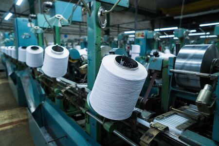 old knitted fabric. Textile factory in spinning production line and a rotating machinery and equipment production company. 版權商用圖片