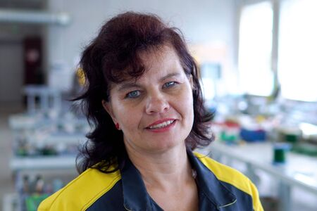 Portrait Of Female Engineer Operating CNC Machinery In Factory 版權商用圖片