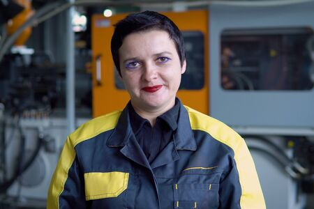 Portrait Of Female Engineer Operating CNC Machinery In Factory Reklamní fotografie