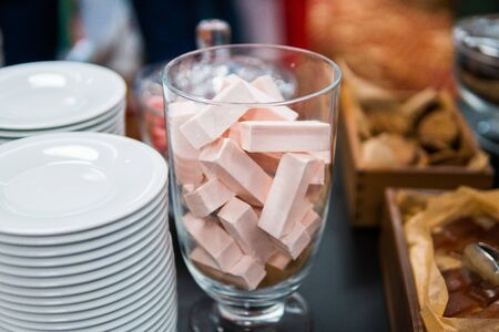 pink marmalade in glassware and other sweets on the buffet table during the coffee break