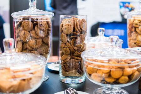 Shortbread cookies in glassware and other sweets on the buffet table during the coffee break