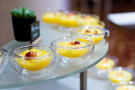 sweet desserts in glassware and other sweets on the buffet table during the coffee break Reklamní fotografie