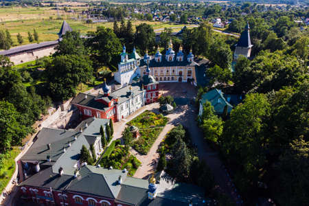 Aerial view at the walls of the Holy Dormition Pskovo-Pechersky Monastery. Pechory, Russia.