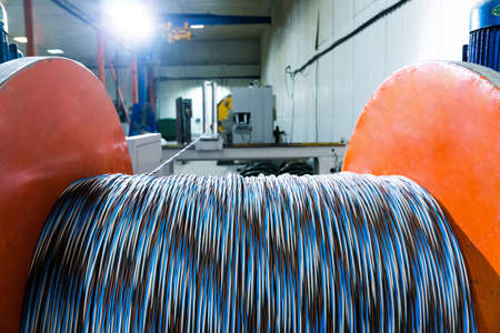 A coil of power electric cable in insulation on a metal coil Reklamní fotografie