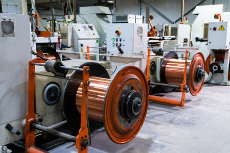 Production of copper wire, bronze cable in reels at factory Foto de archivo