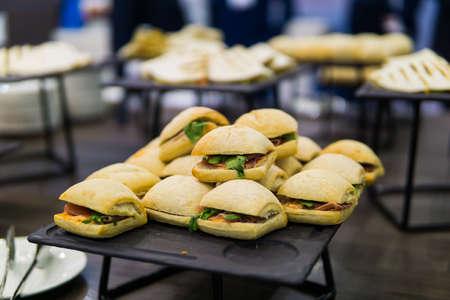mini burgers on a tray. Catering party Reklamní fotografie