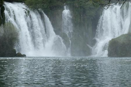 SACRED EARTH IN THE KRAVICA WATERFALL BOSNIA WATERFALL