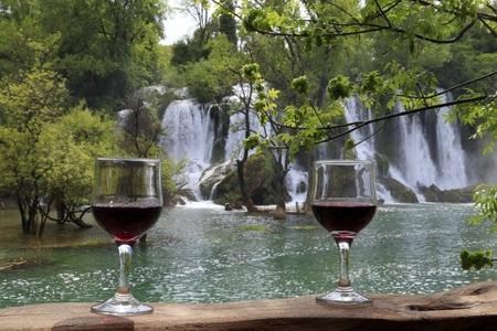 A GOOD WINE NEAR THE KRAVICA WATERFALL BOSNIA WATERFALL