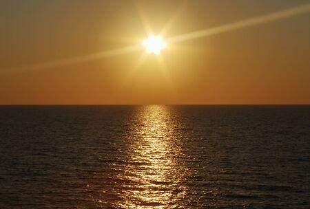 the sun hides in the tirreno.