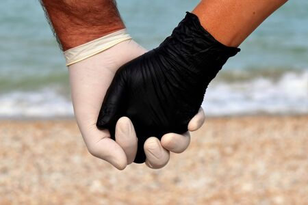hands protected by covid-19 holidays 2020.