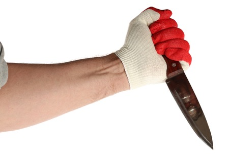 miscreant: Hand in work gloves fingers painted as blood is holding a large knife. On a white background. Stock Photo