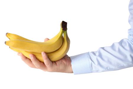 banane: Banana dans la main. Isolement sur un fond blanc.