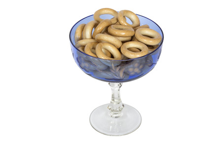 baranka: Glass bowl  with bagels. Isolation on a white background. Clipping path.