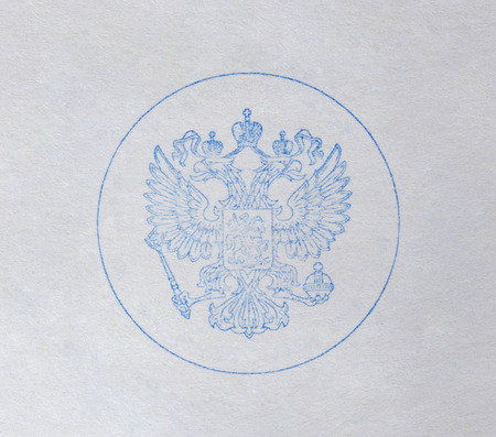 doubleheaded: A print of the double-headed eagle on the white paper. Stock Photo