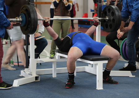 agonist: Competitions on powerlifting (weight lifting). Weightlifter pushes the barbell  on the competition