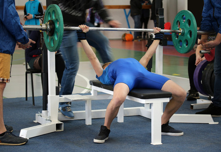 agonist: Competitions on powerlifting (weight lifting). Weightlifter pushes the barbell on the competition Stock Photo