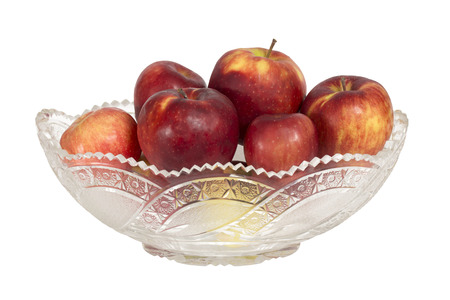 crystal bowl: Crystal bowl with apples. Isolation on a white background. Clipping path. Stock Photo