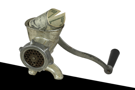 savings and loan crisis: Metaphor inflation. Money is scroll through a meat grinder Stock Photo