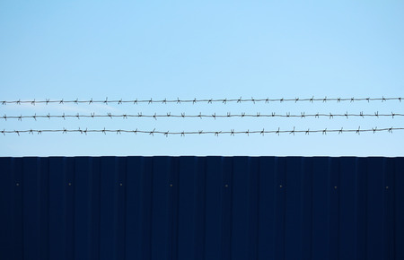 imprisonment: Imprisonment and freedom on opposite sides of the barbed wire
