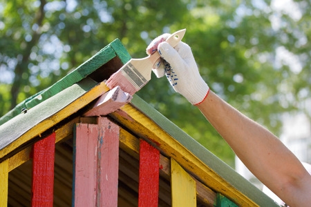 colouration: The painter paints the roof of toy house