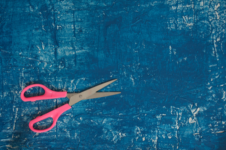 bespoke: Blue background with pink scissors