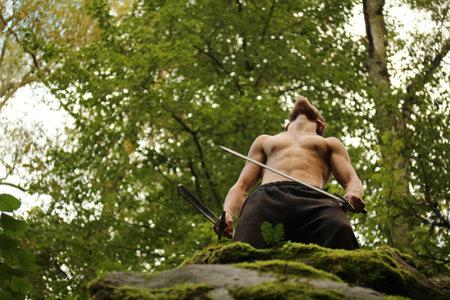 swordsman: 3 September 2016. Kozelsk, Russia. Swordsman in the forest