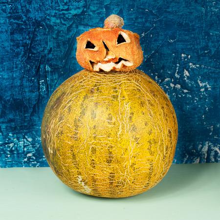 Horror at Halloween. Jack-o-lantern (pumpkin and melon) Stock Photo