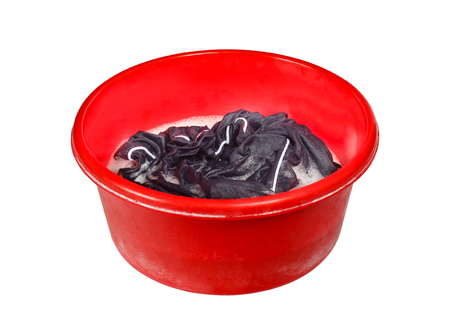 soak: Soak dirty clothes in the basin. Isolation on a white background.