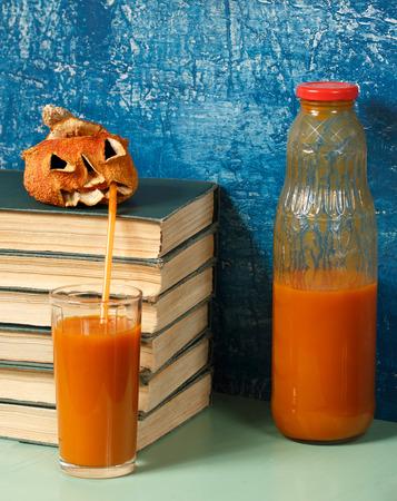 Jack-o-lantern is drinking pumpkin juice