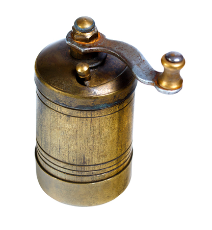 Old-fashioned pepper ,spice, coffee mill isolated on a white background Stock Photo