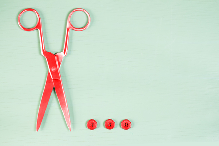 innuendo: Pop art background. Scissors and buttons on close up on wooden board